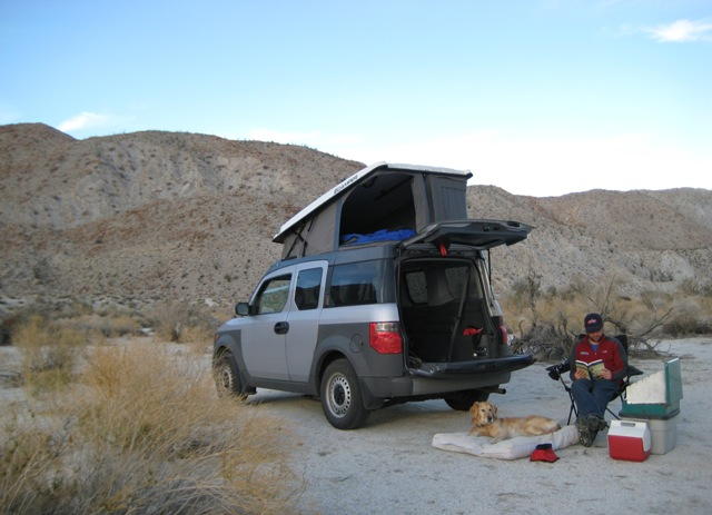 A pop-top for a Honda Element! No cutting - it uses the sunroof as access.